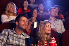 young-people-sitting-movie-theater-auditorium-watching-33785779